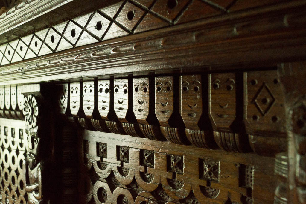 Faces carved into the fireplace in the main bedroom