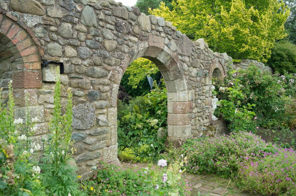 An ornate archway into the next 'room' at Larch Cottage Nurseries, Melkinthorpe