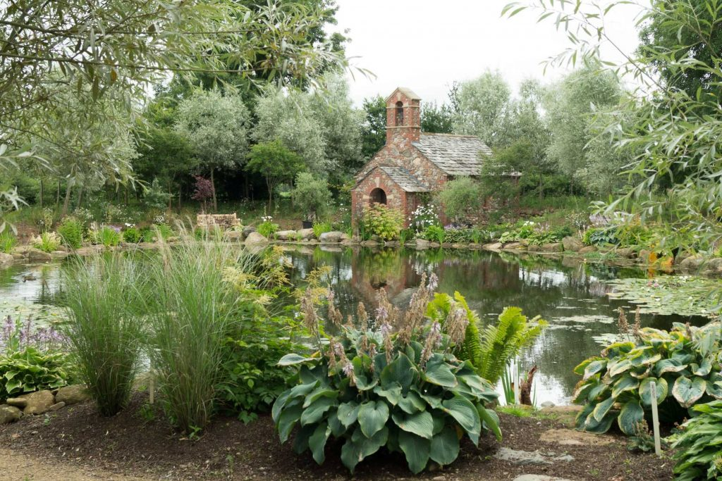 The chapel and lake at Larch Cottage Nurseries