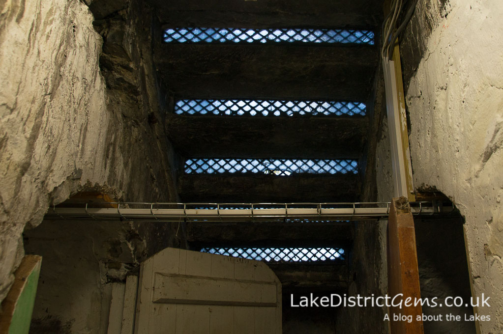 Steps above the cellars on a hard hat tour of Wray Castle