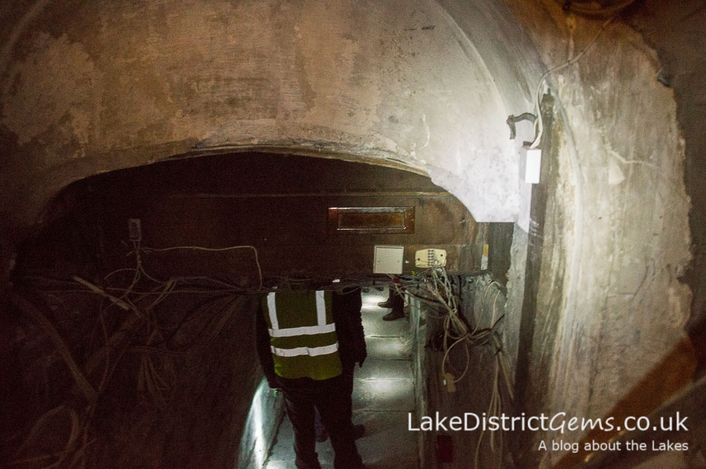 Entering the cellars on a hard hat tour of Wray Castle