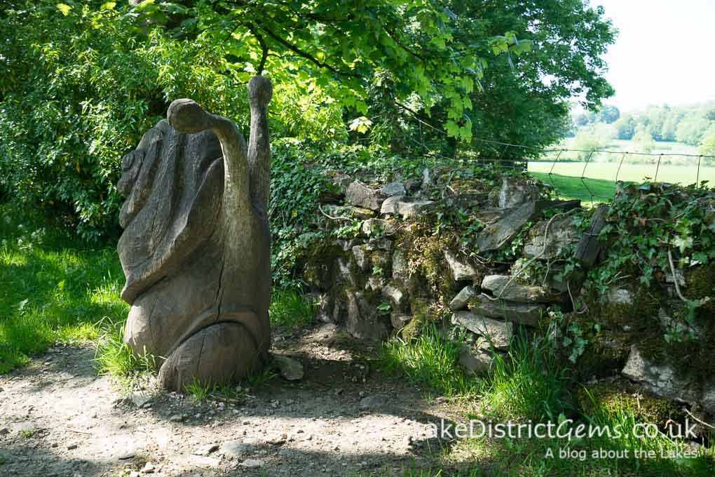 A wooden snail sculpture at Sizergh Castle